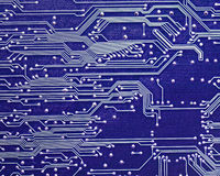 Computer circuit board in blue Royalty Free Stock Photography