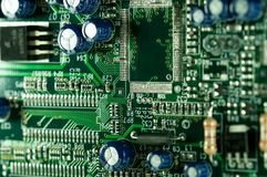 Computer circuit board close up macro shot in green. Color Stock Photography