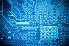 Computer circuit board closeup. Blue abstract technology background Royalty Free Stock Photos
