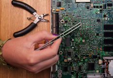 Computer circuit board fixing Royalty Free Stock Photos