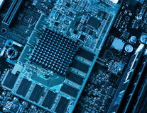 Computer circuit board and processors. Computer components circuit board and processors closeup blue Royalty Free Stock Image