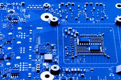 Computer circuit board showing the components on a pattern. Grid. Computer motherboard background stock image