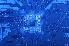 Computer Circuit Board. View of an Circuit board with Semiconductor components in blue monochrome color Royalty Free Stock Photo