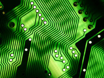 Computer Circuitboard Texture. Abstract perspective on computer parts in glowing green and black patterns ideal as background or texture royalty free stock photo