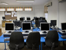 Computer class. Room with plenty desktops and TFT screens Royalty Free Stock Photo