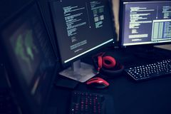 Computer code on screens cyber crime concept royalty free stock photo