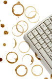 Computer and coffee stains Stock Images