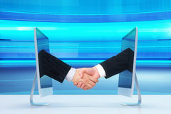 Computer communication concept with human handshake Royalty Free Stock Photo