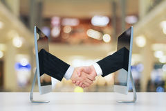 Computer communication concept with human handshake. Close up Royalty Free Stock Photos