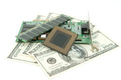 Computer components and money on white Stock Images
