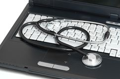 Computer concept with stethoscope on laptop, Stock Photography