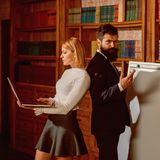 Computer concept. Woman and man develop new project using computer. University students surfing Internet in laptop. Computer concept. Woman and men develop new royalty free stock photos