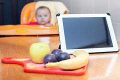 Computer for cooking. Preparation for baby food Stock Photo