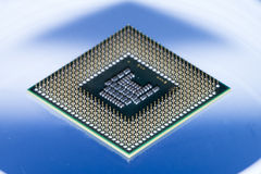 Computer CPU on a blue light background Royalty Free Stock Images