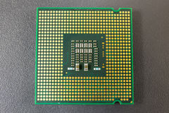Computer CPU Chip on black surface Royalty Free Stock Photo