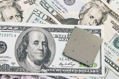 Computer CPU chip on 100 US dollar banknotes Stock Photography
