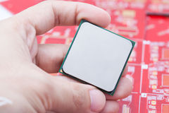 Computer CPU on hand Stock Images