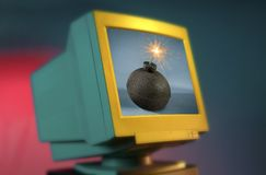 Computer crashes. A computer monitor with a round bomb and lit fuse on the screen Royalty Free Stock Photo