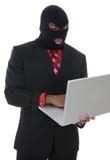 Computer Crime. A conceptual business man computer crime theme stock photos