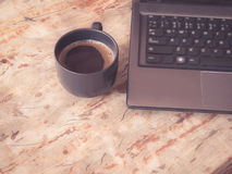 Computer and a cup of coffee Royalty Free Stock Photos