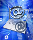 Computer Cyberspace Business Technology. A metal email alias symbol or at sign coming out of a computer screen with a circuit background Royalty Free Stock Photography