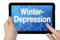 Computer della compressa con la parola tedesca per la depressione di inverno - Winterdepression immagine stock libera da diritti