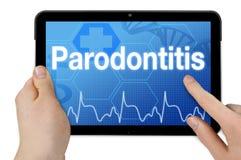 Computer della compressa con la parola tedesca per il periodontitis - Parodontitis fotografia stock