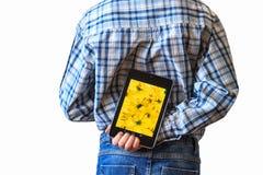 Computer della compressa della tenuta del ragazzo dietro il suo indietro Fotografie Stock Libere da Diritti