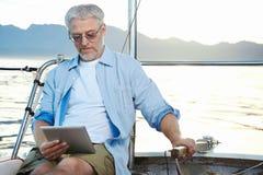 Computer della compressa sulla barca Fotografia Stock