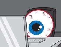 Computer Desk Eye Bloodshot. Large bloodshot eye staring at computer Royalty Free Stock Image