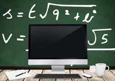 Computer Desk foreground with blackboard graphics of formulas. Digital composite of Computer Desk foreground with blackboard graphics of formulas Royalty Free Stock Images