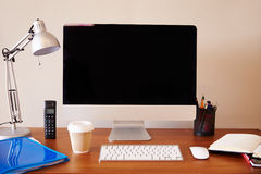 Computer On Desk In Home Office Stock Photo