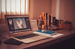 Computer on desk inside home Stock Photography