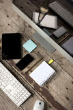 Computer desk with phone and tablet Royalty Free Stock Photos