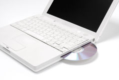 Computer disc drive. With DVD isolated on white Stock Photos