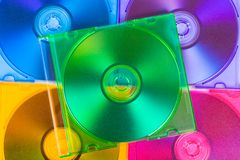 Computer disks in multiciolored boxes Royalty Free Stock Photos