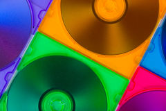 Computer disks in multiciolored boxes Stock Image