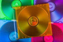 Computer disks in multiciolored boxes Stock Photos