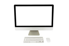 Computer display with blank screen and wireless keyboard Stock Photos