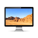 Computer display with mountain landscape Stock Photos