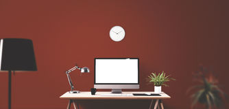 Computer display and office tools on desk. Desktop computer screen isolated. Modern creative workspace background. Front view Royalty Free Stock Images