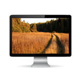 Computer display with wallpaper Stock Images