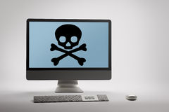 Computer displaying internet fraud and scam warning on screen. Desktop computer displaying conceptual internet fraud and scam warning on screen stock photography