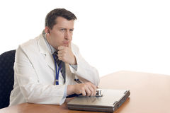 Computer Doctor. Medical Doctor makes Computer Diagnosis with a laptop Stock Photo