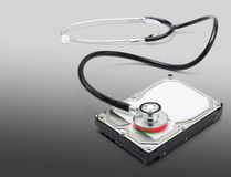Computer doctor recovering lost data information Royalty Free Stock Photo