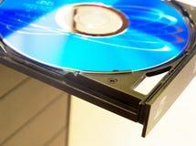 Computer dvd reader. A close-up of a computer dvd tray Royalty Free Stock Photos