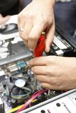 Computer and electronics repair,. Screwdriver and screwdriver Royalty Free Stock Photos