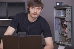 Computer engineer. Male computer engineer on his workplace with many laptops Royalty Free Stock Image