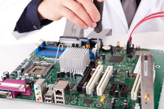 Computer Engineer. Working on a old motherboard Royalty Free Stock Images