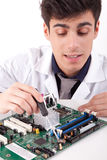 Computer Engineer. Working on an old motherboard Stock Photos